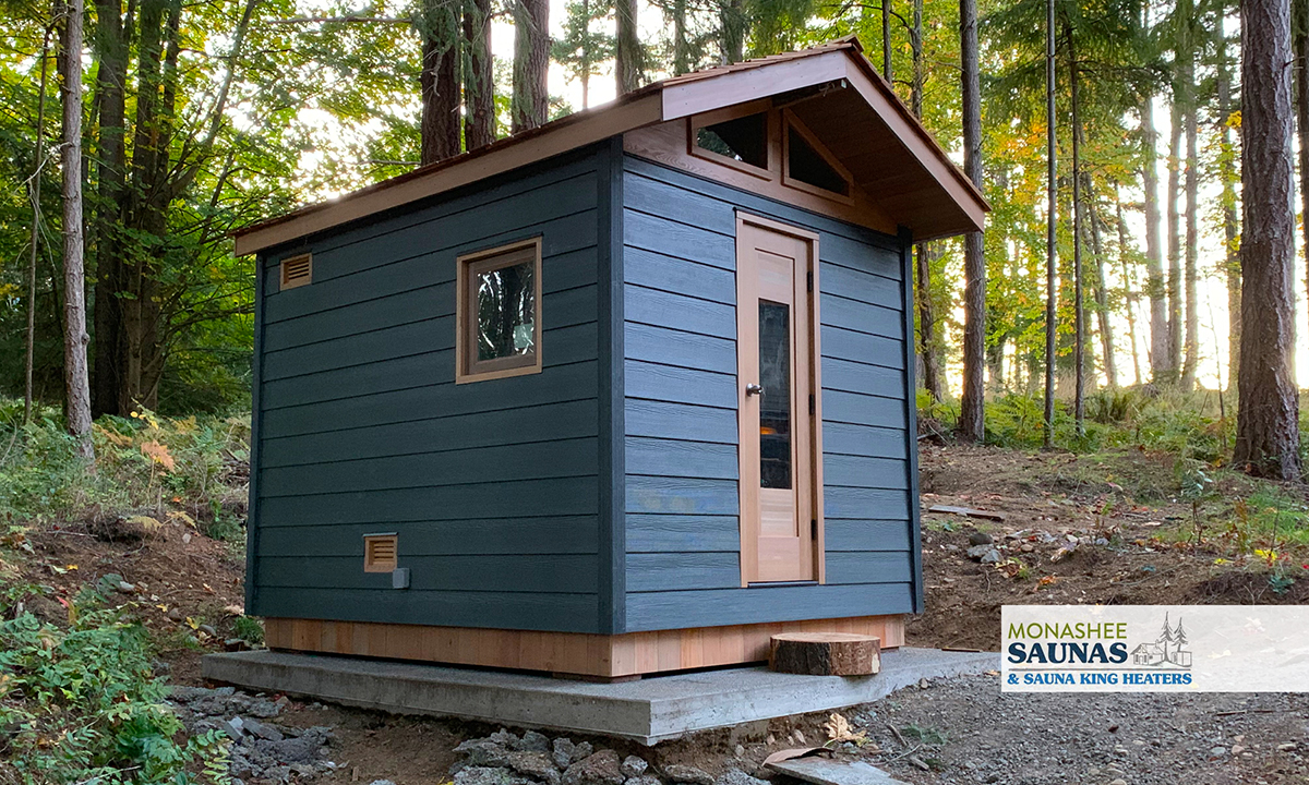 Traditional cabin style outdoor sauna with vaulted ceiling by Monashee Saunas